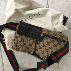 Gucci logo fanny pack with protective tote bag